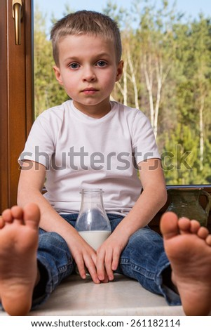 Young boy with milk botlle - stock photo