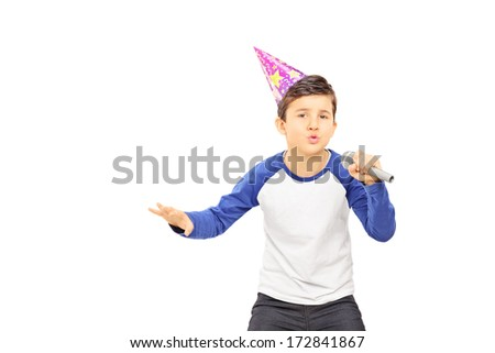 Young  boy with party hat singing on microphone isolated on white background