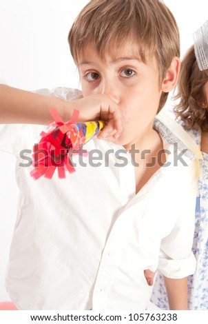 Young boy with party horn blower - stock photo