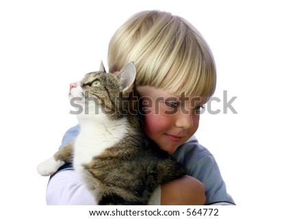 Young boy with pet cat in arm - stock photo