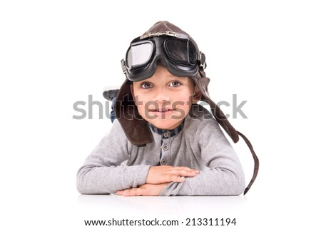 Young boy with pilot  helmet isolated in white - stock photo