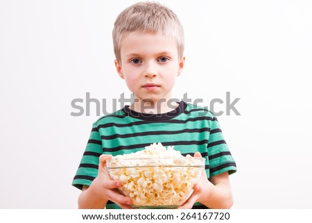 Young boy with popcorn