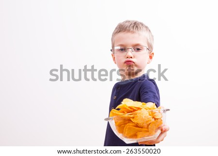 Young boy with potato chips
