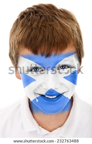 Young boy with Scottish flag painted on his face - stock photo
