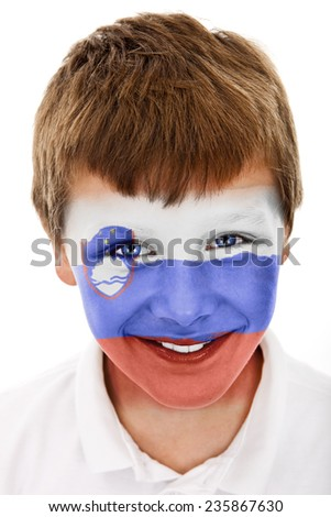 Young boy with slovenia flag painted on his face - stock photo