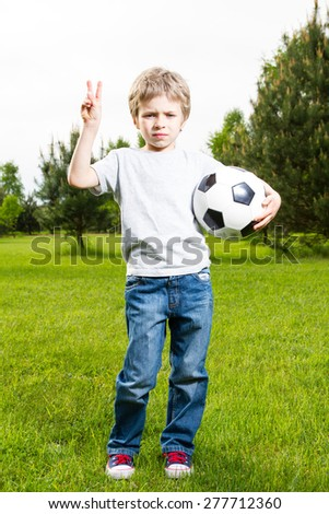 Young boy with soocer ball - stock photo