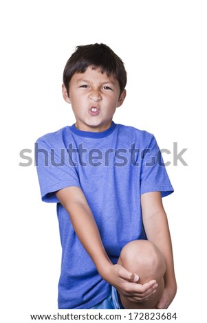 Young boy with sore leg and knee on white background