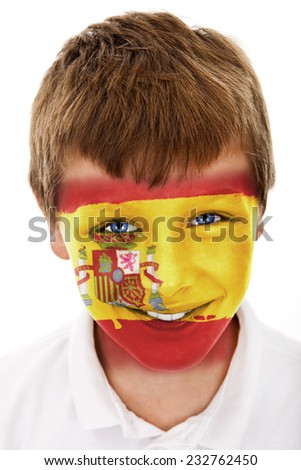 Young boy with Spanish flag painted on his face - stock photo
