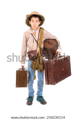 Young boy with suitcases playing Safari isolated in white