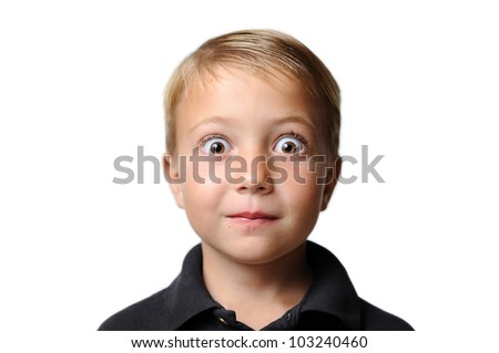 Young Boy with Surprised Look. Young boy with very large eyes appearing to be surprised. Isolated on a white background. Shallow depth of field. - stock photo