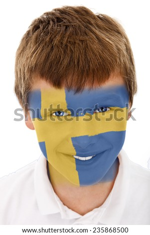 Young boy with swedish flag painted on his face - stock photo