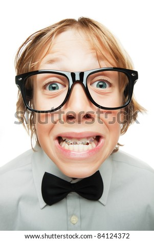 Young boy with tooh braces isolated on white background - stock photo