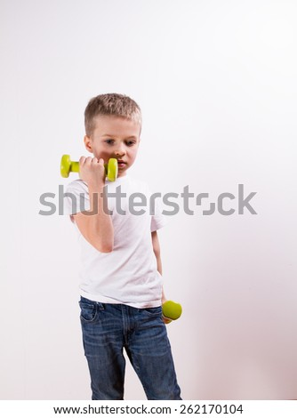 Young boy with weights Fitness - stock photo