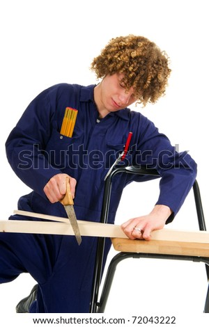 Young boy working as carpenter with timbers and tools