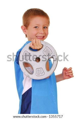 Young boy working out with weights