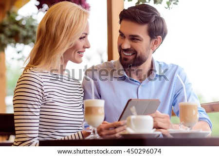 Young boyfriend and girlfriend resting in cafe - stock photo