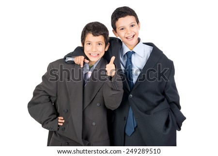 Young boys dressed with a big man's suit