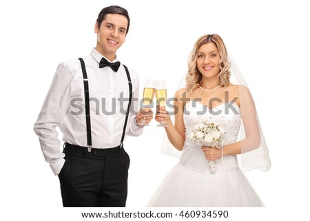 Young bride and groom making a toast with white wine and looking at the camera isolated on white background