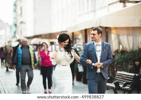 young bride and groom  walking in the beautiful town