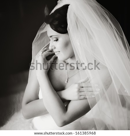 Young bride in the morning at home. Black and white picture - stock photo