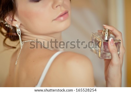 young bride is getting ready at home in the morning, wedding day - stock photo