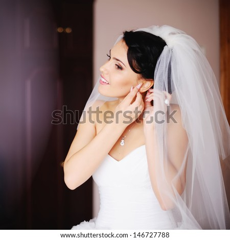 young bride is getting ready at home, wedding day - stock photo