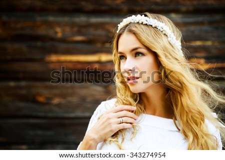 Young Bride with Wedding Tiara on Wooden Background. Modern Bridal Style. Copy Space.