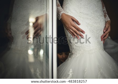 young bride wore a beautiful white dress