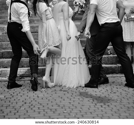 young bridesmaids with groomsmen - stock photo