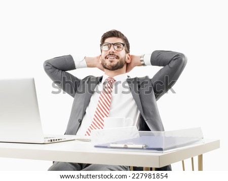 Young broker sitting at desk and relaxing against white background.
