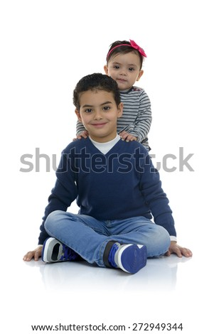 Young Brother with his Little Sister Isolated on White Background - stock photo