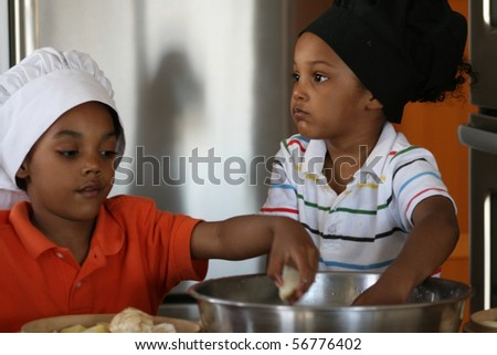 Young brothers preparing a delicious dinner.
