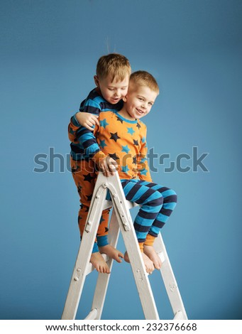 Young brothers reaching stars - stock photo