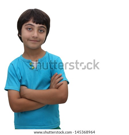 young brown haired boy with arms crossed isolated on a white background - stock photo