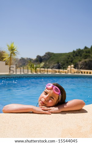 Young Brown Haired Child in Swimming Pool - stock photo