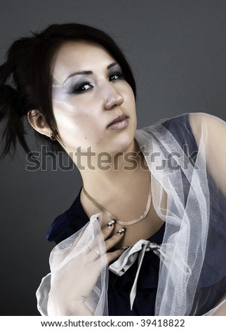 Young brunette asian style: posing
