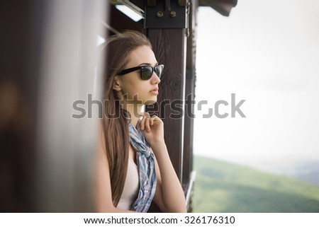 Young brunette beauty enjoying view of the mountains. - stock photo