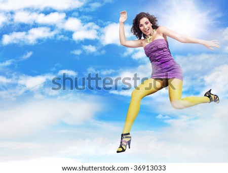 Young brunette beauty jumping over sky background, lots of copy-space