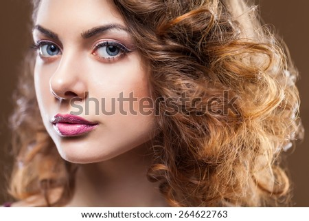 Young brunette beauty over brown background