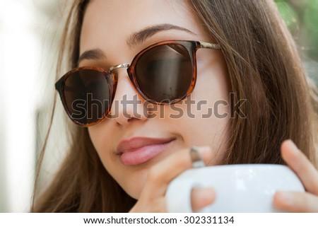 Young brunette beauty tourist having stylish summer coffee fun. - stock photo