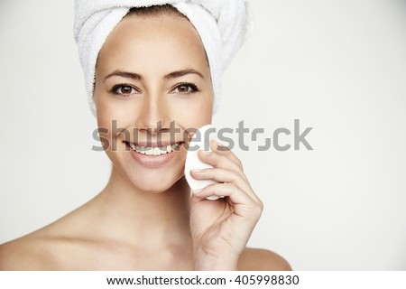 Young brunette beauty treatment smiling at camera