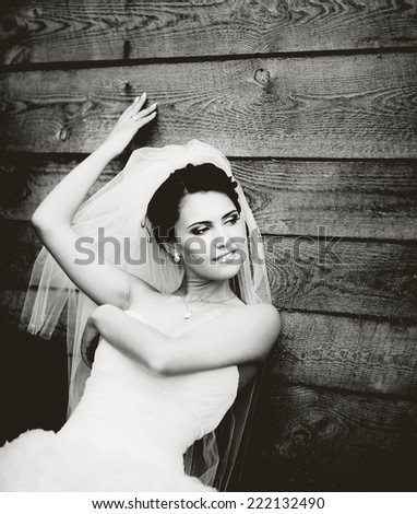 Young brunette bride on wedding day in black and white.  - stock photo