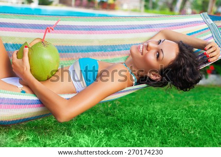 Young brunette chilling in a hammock - stock photo