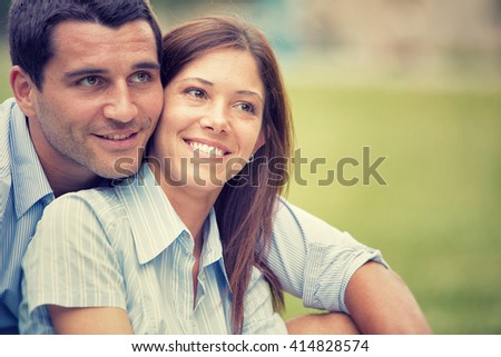 young brunette couple having fun together at park