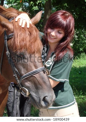 Young brunette female model closeup portrait with brown horse