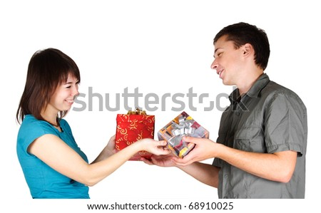 young brunette girl and man present gifts to each other and smiling, isolated - stock photo