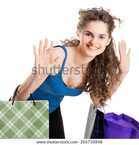 Young brunette girl holding bags and gifts after shopping - stock photo