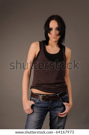 Young brunette girl in rumpled shirt and jeans.