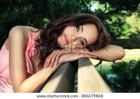 Young brunette girl resting in nature