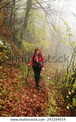 Young brunette girl trekking in Mehedinti Mountains, Romania, Europe  - stock photo